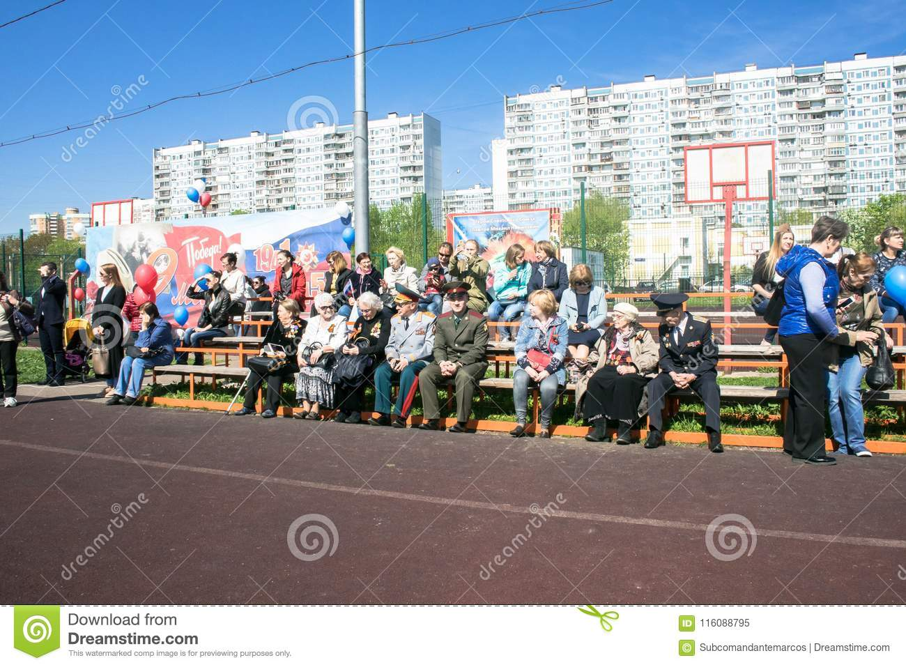 Russia. Moscow, May,07.18: Viewers at the crowded school stadium on the special public kindergarten action `Immortal regiment`