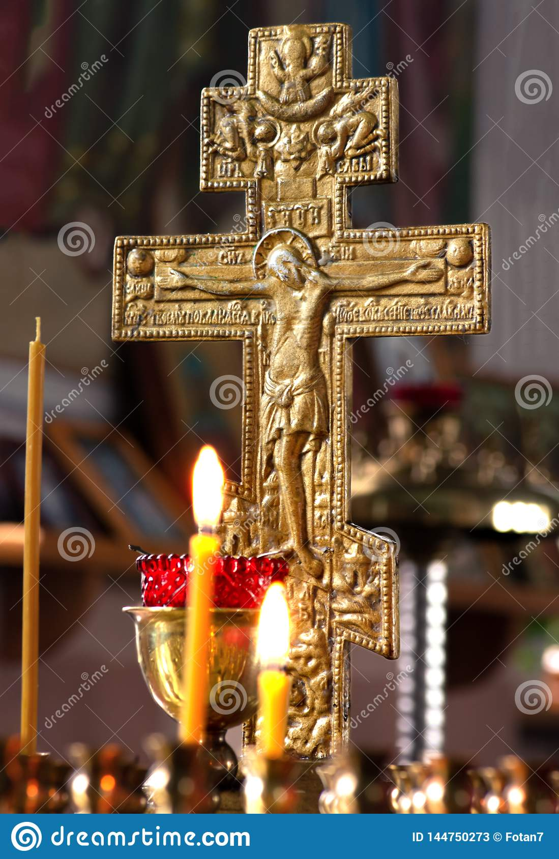Russia, Ryazan 1 Feb 2019 - candles on the background of a gilded cross in the Orthodox Church natural light