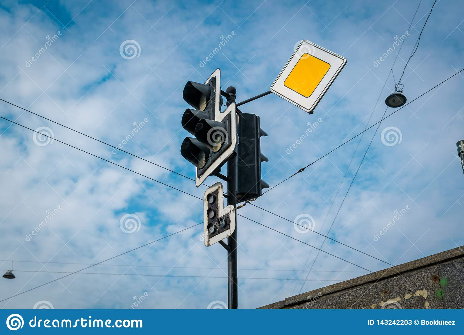 The traffic light with yellow sign.