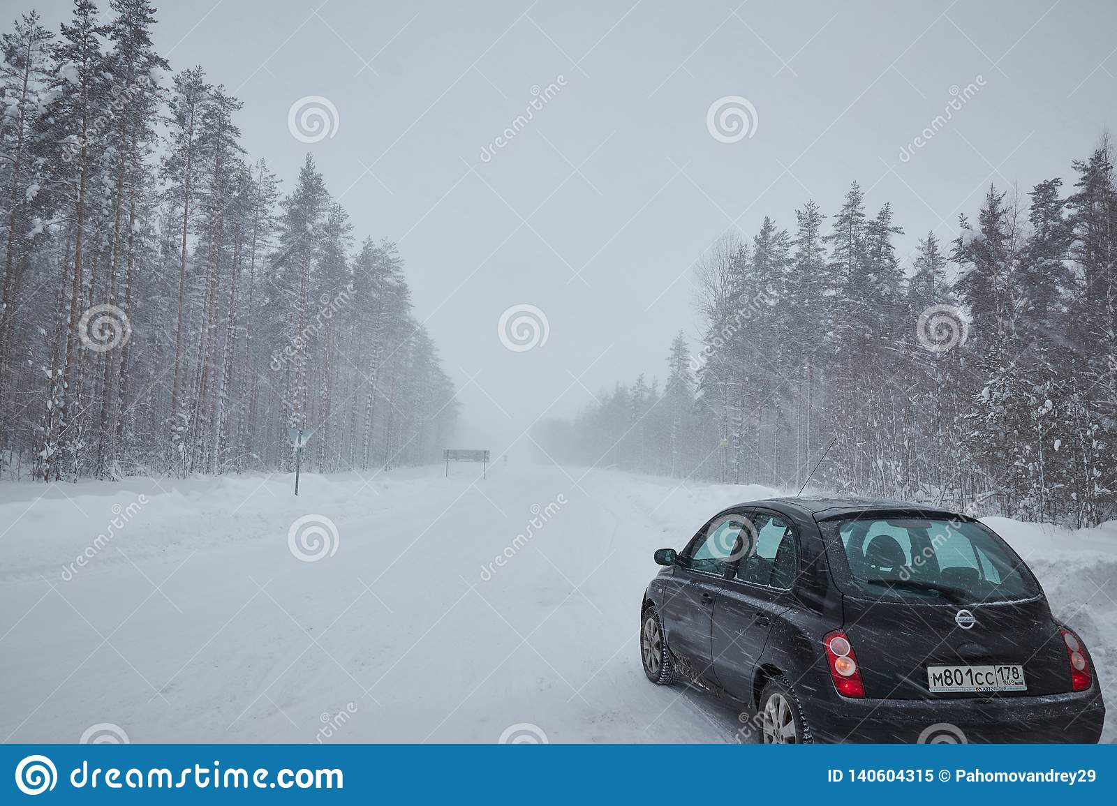 Russia. Saint-Petersburg. suburban. January 2019. heavy snow precipitation. car with snow