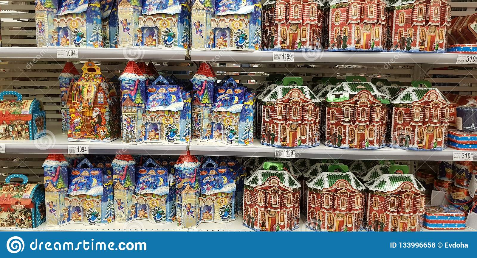 Christmas gift wrapping with sweets in the supermarket