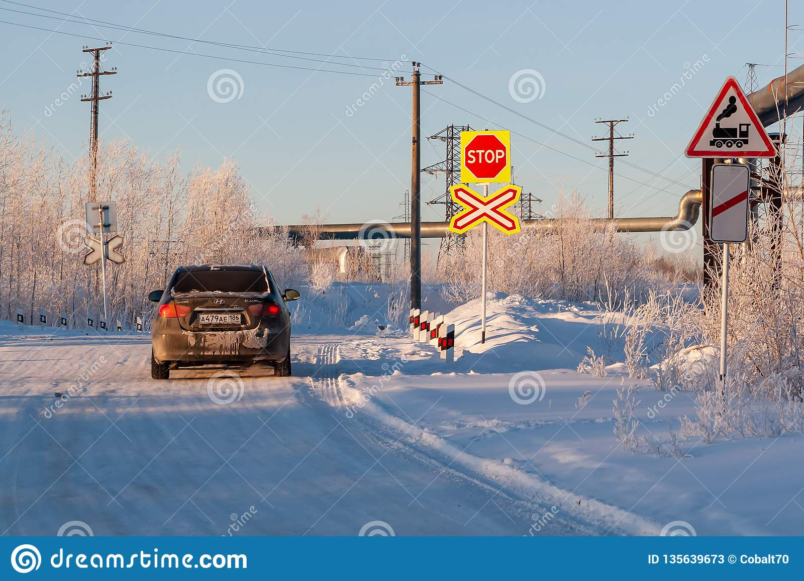 Railway crossing in winter. Road sign