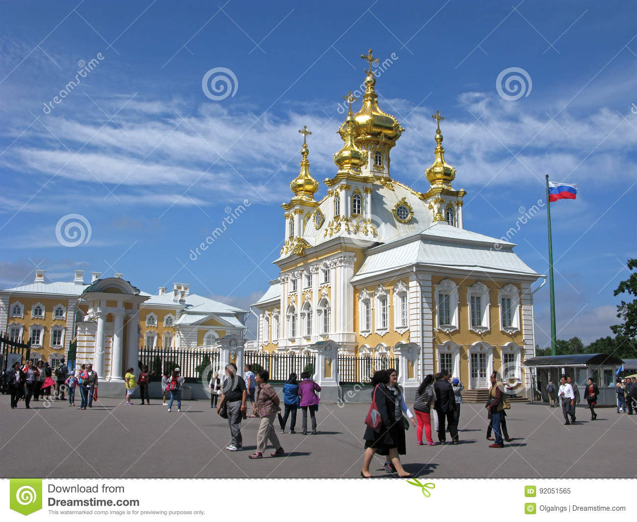 Russia. Tourists in Peterhof, church of Peter and Paul.