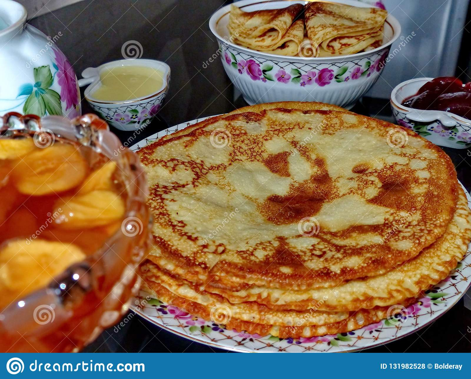 Russian blini pancakes and apple jam, condensed milk, honey. Celebration of Maslenitsa. Maslenitsa is an Eastern