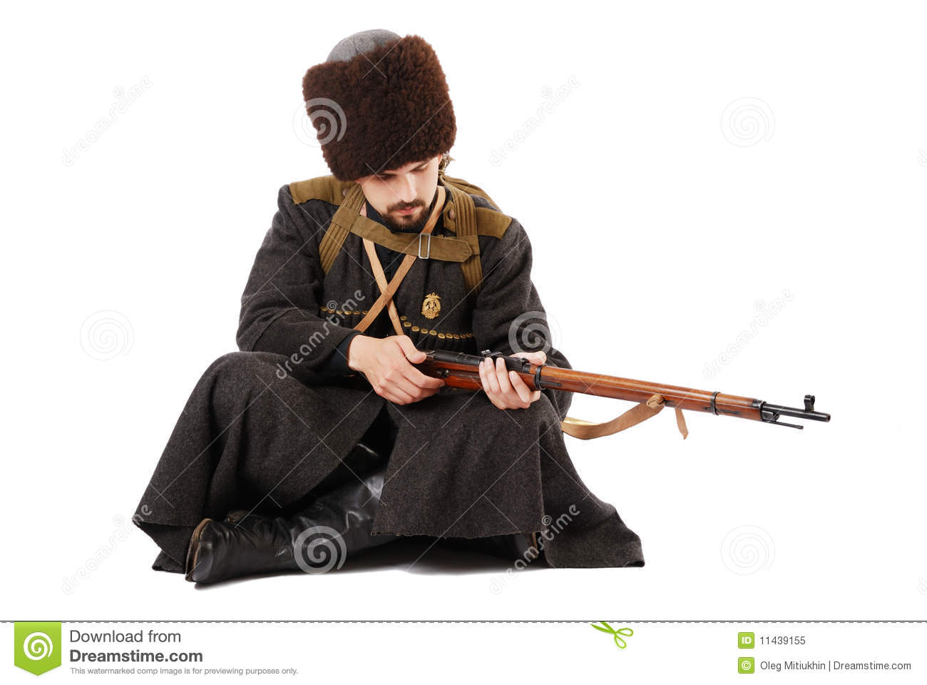 Russian Cossack Inspecting A Rifle Royalty Free Stock