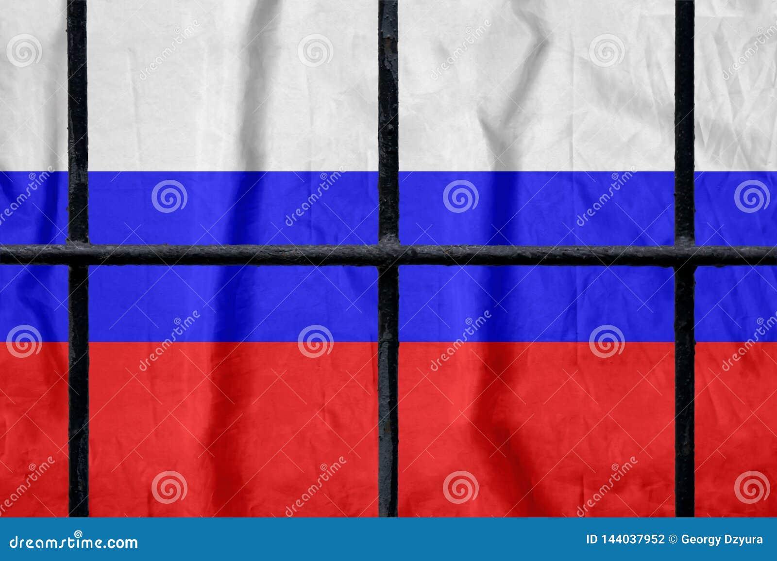 Russian flag behind black metal prison bars