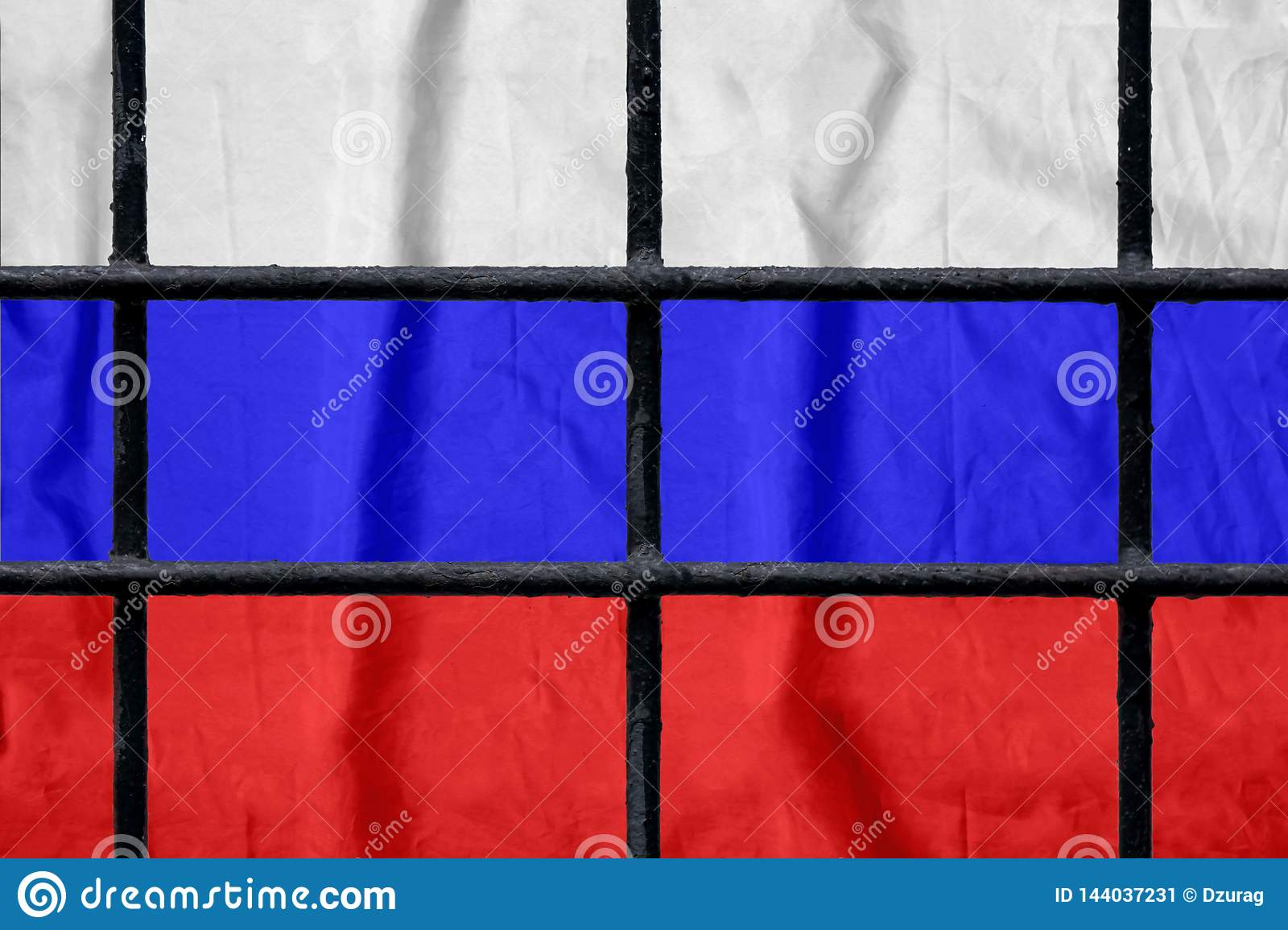 Russian flag behind black metal prison bars