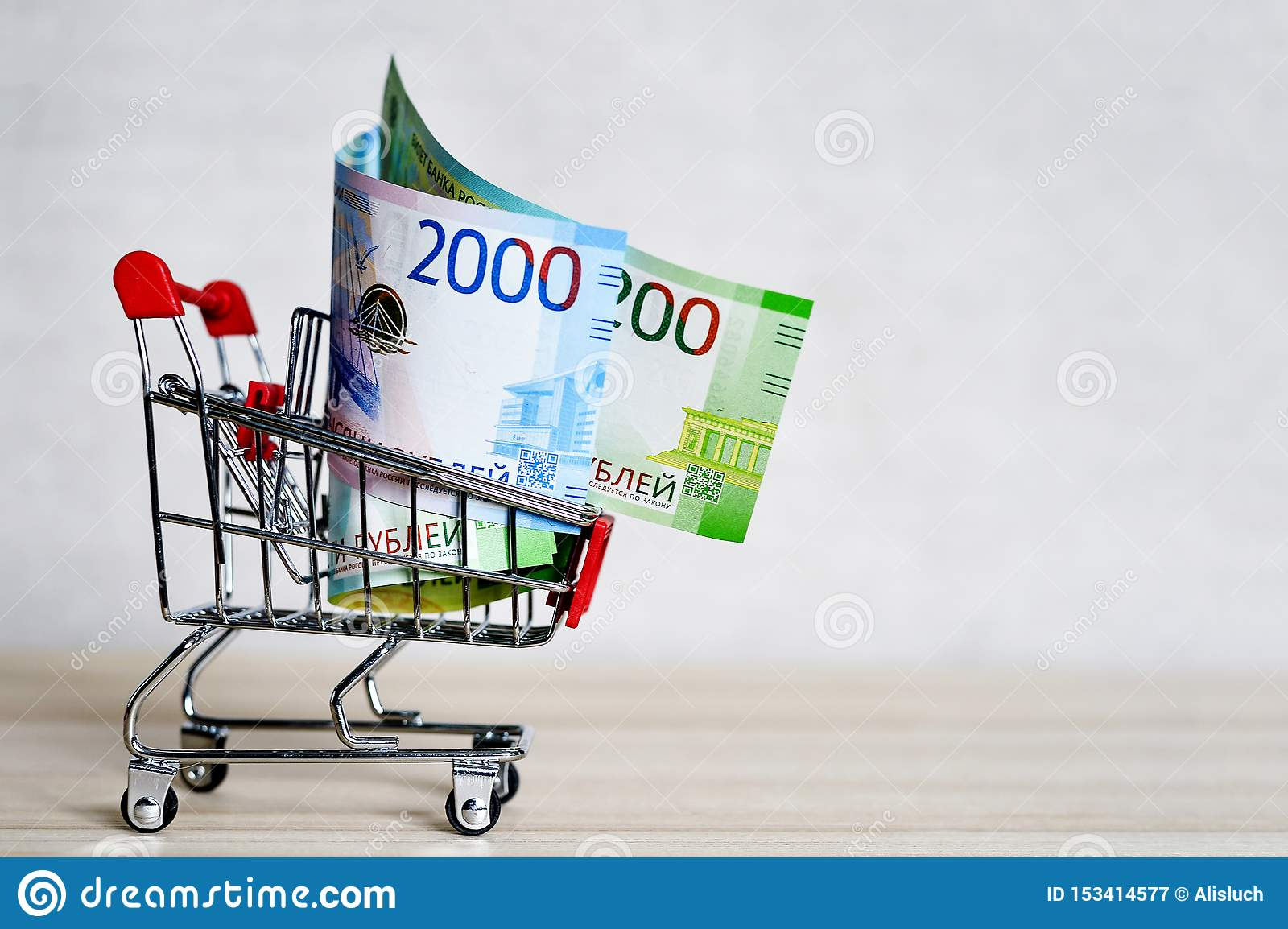 Russian money banknotes in a shopping trolley, online shopping concept