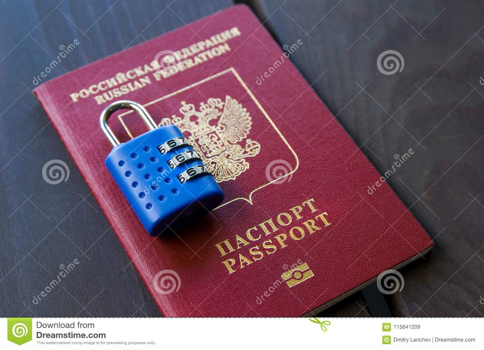 Russian passport locked to padlock. Symbol of anti-Russian sanctions