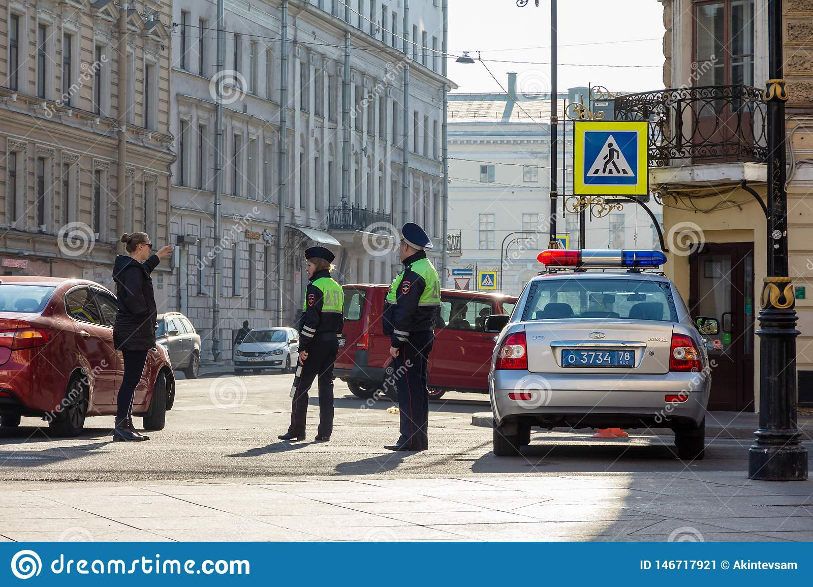 Russian Patrol Police Car And Two Cops Talking To A Woman Editorial