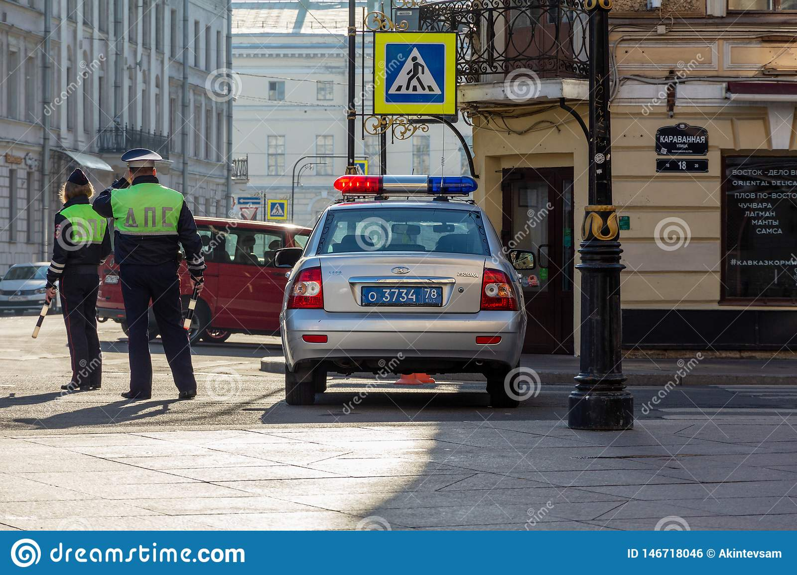Russian Patrol Police Car And Two Cops Editorial Photo - Image of