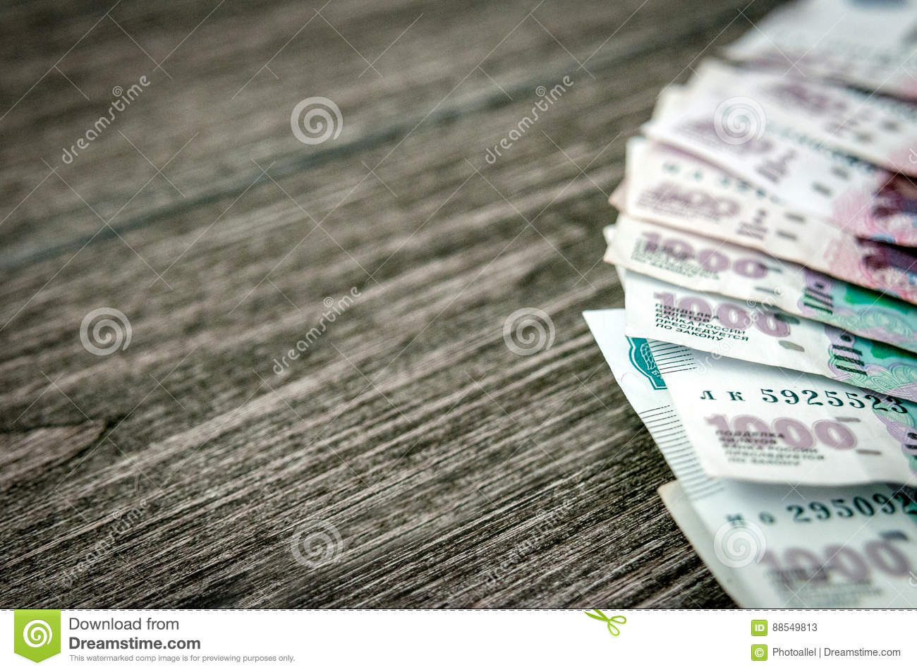 russian ruble banknotes money on dark wood background stock image