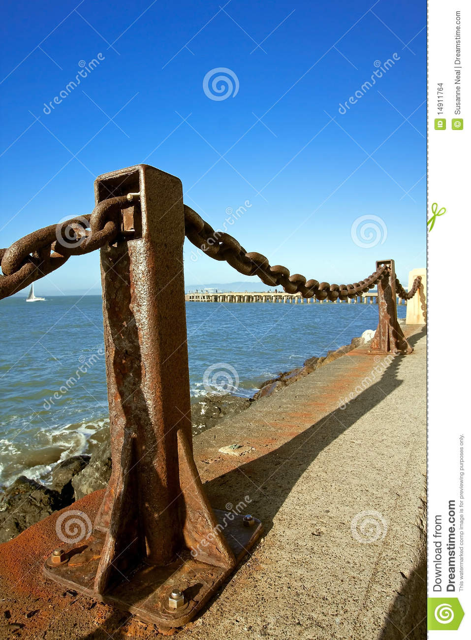 Rusted Metal Post And Chain Fence By Bay Stock Photo
