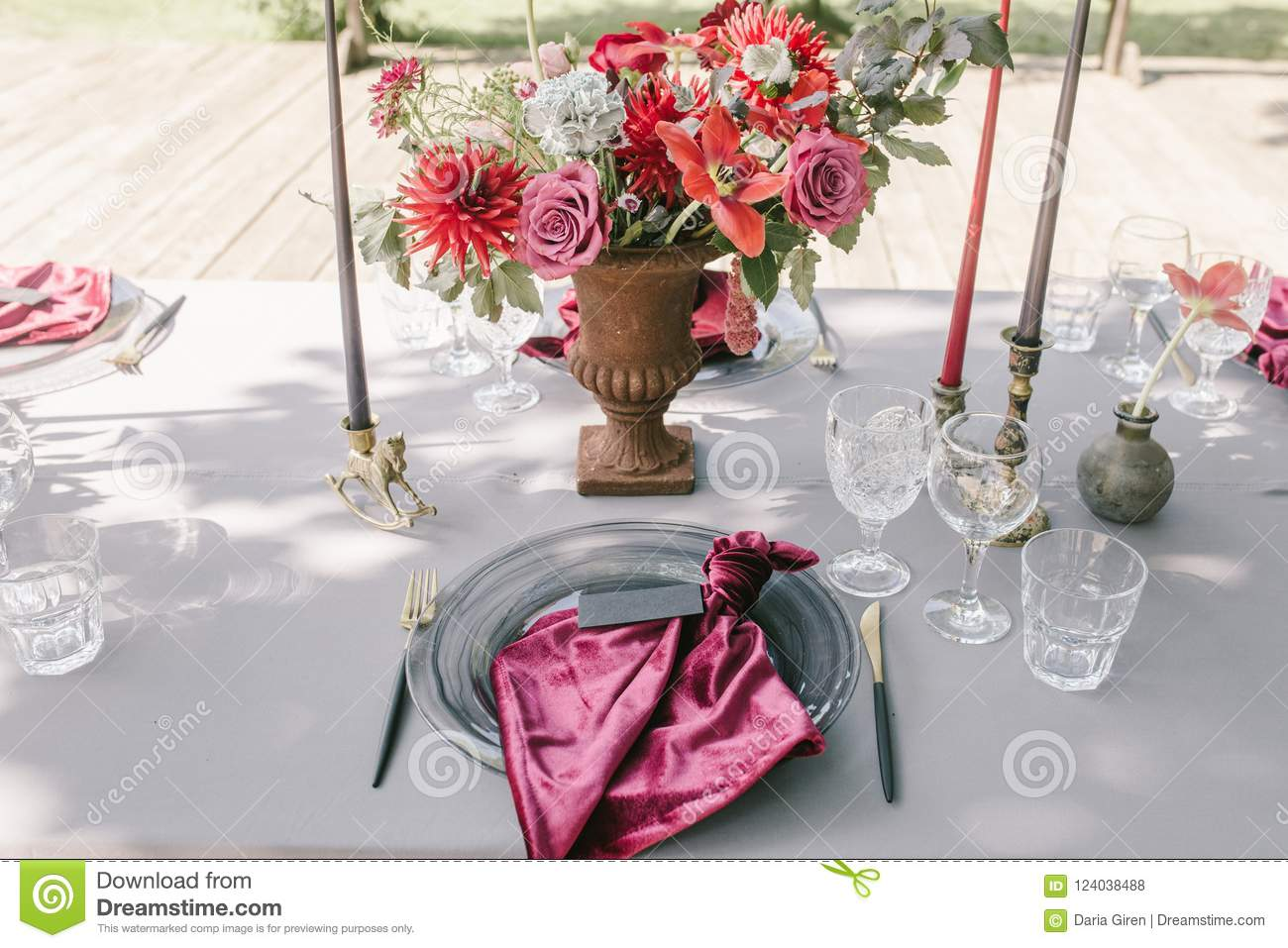 Rustic Banquet Candels Glasses Red And Pink Flowers Elegance And