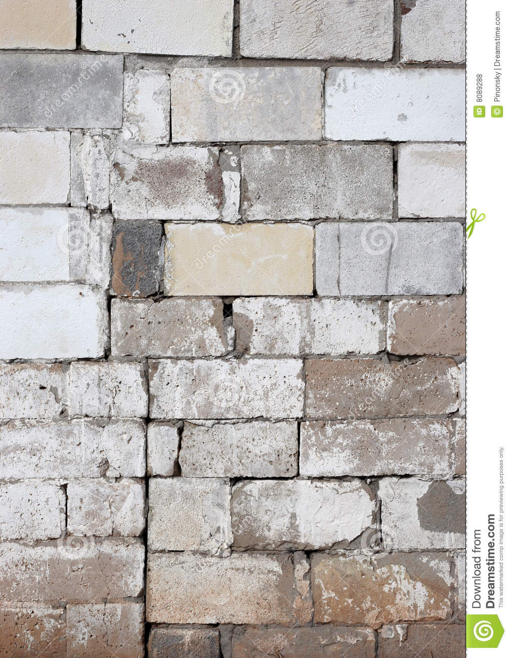rustic block wall with fading white paint stock photo