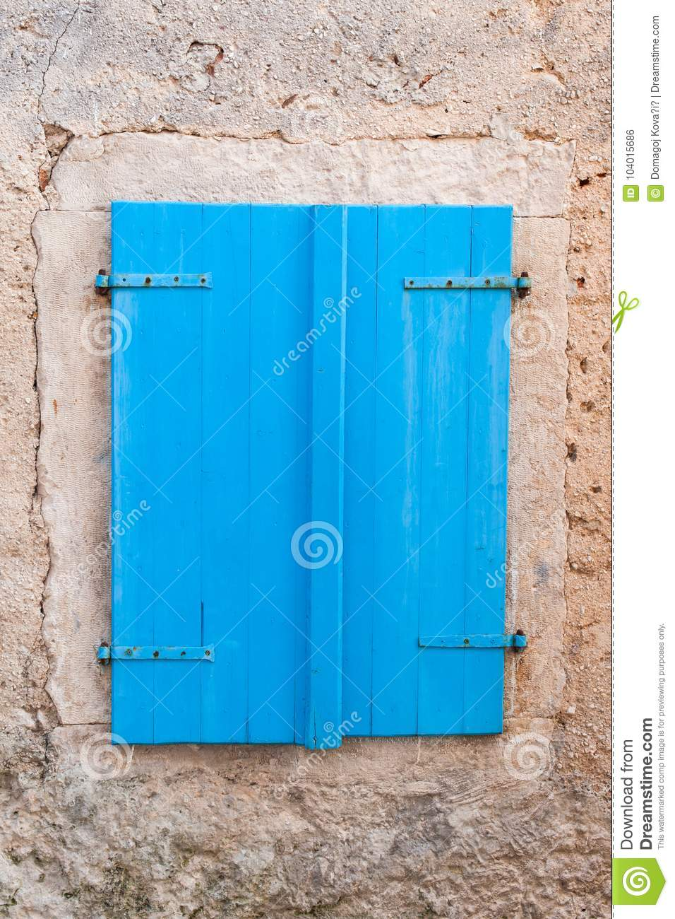 Rustic Blue Window Closed With Wooden Exterior Shutters Stock Photo ...
