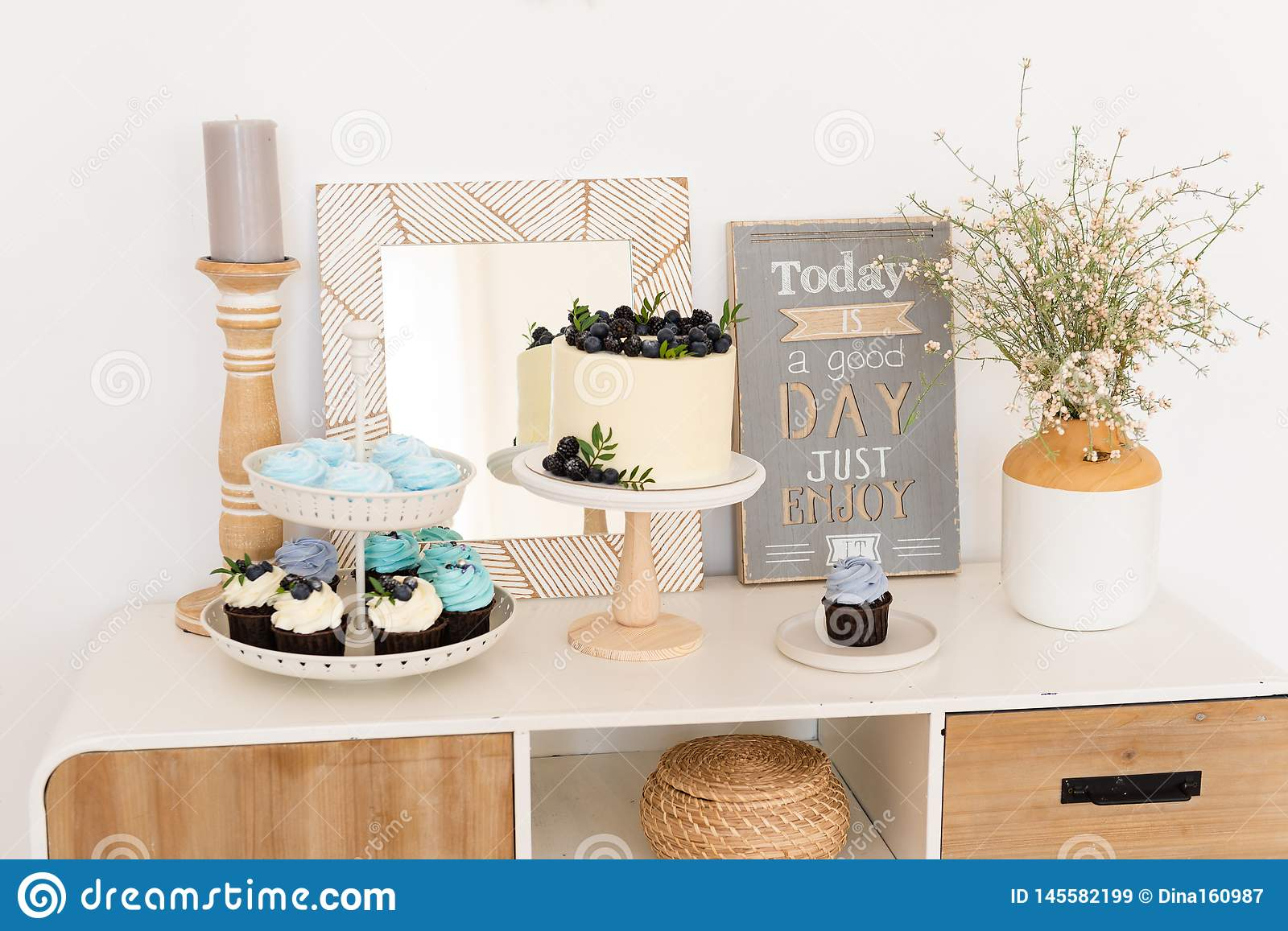 Picture of: Rustic Boho Candy Bar Table With Cake Cupcakes And Different Sweets For Party Birthday Party Confectionery Bakery Concept Stock Image Image Of Buffet Cream 145582199