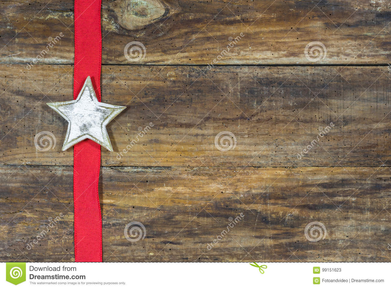 Rustic Christmas Star on wooden board with red ribbon.