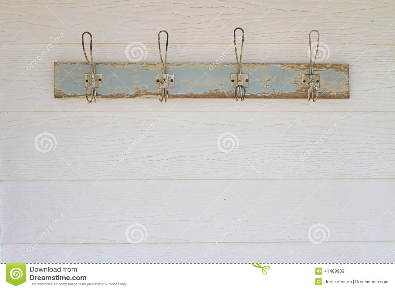 Rustic coat hooks background on white weatherboard house