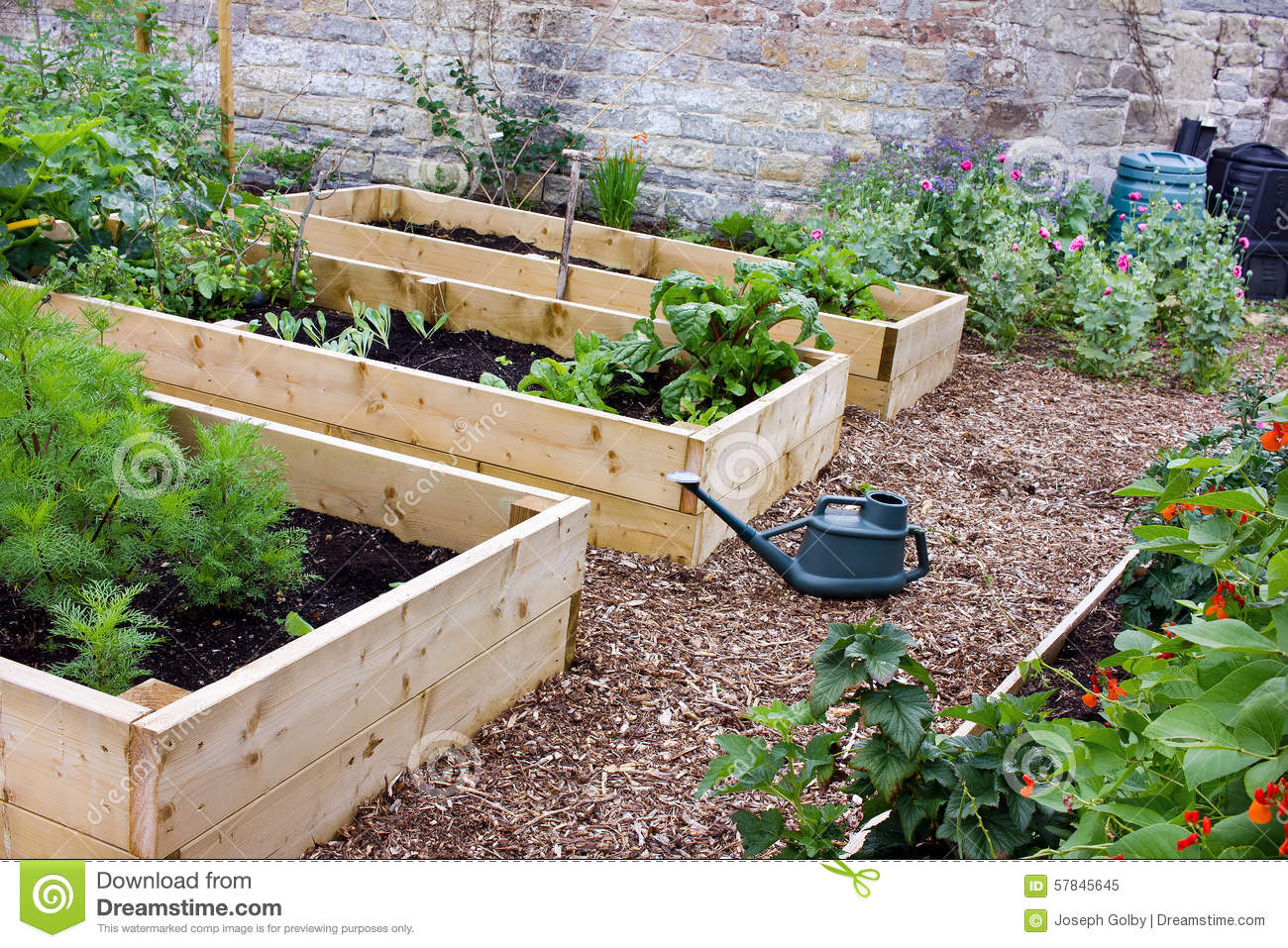 Rustic Country Vegetable Flower Garden With Raised Beds Spade Watering Can Composters