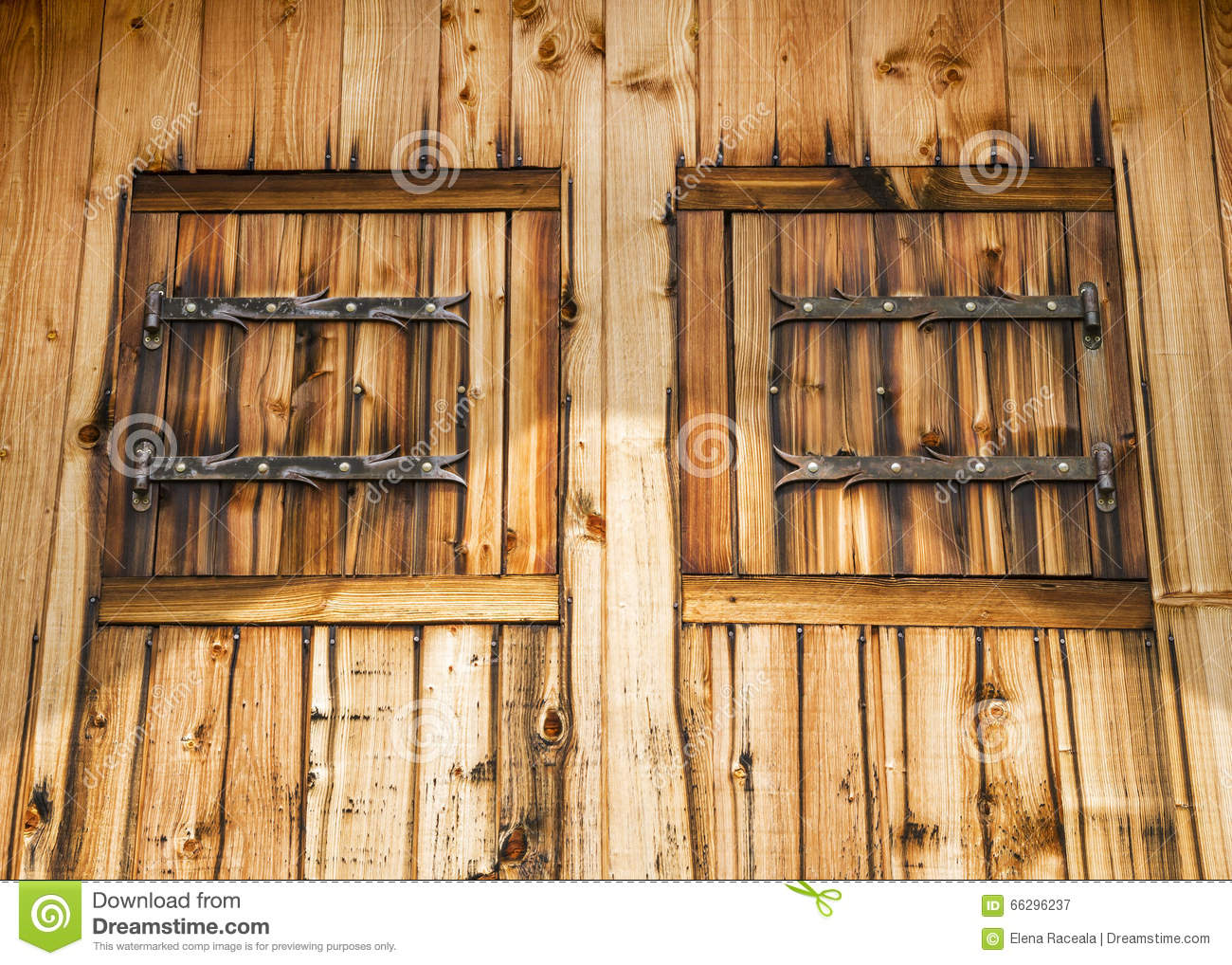 Rustic facade of a wooden house with wooden shutters stock for Rustic wood homes