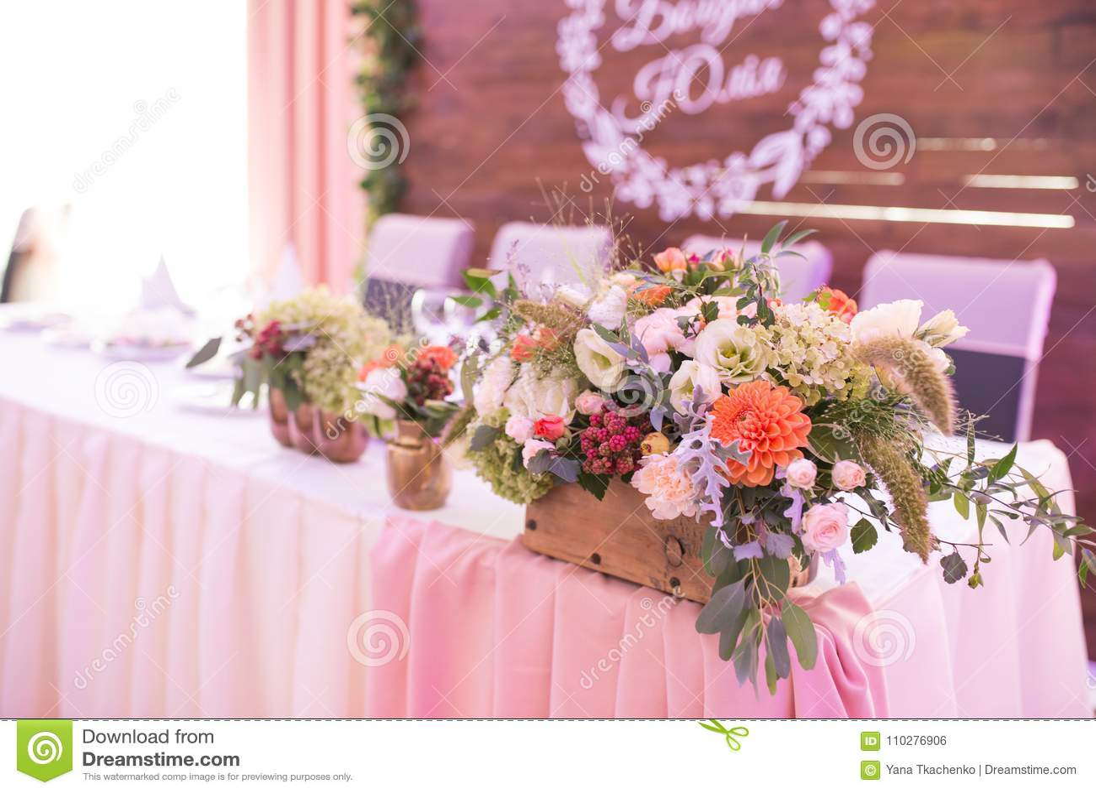 Rustic Flower Arrangement At A Wedding Banquet. Table Set For An ...