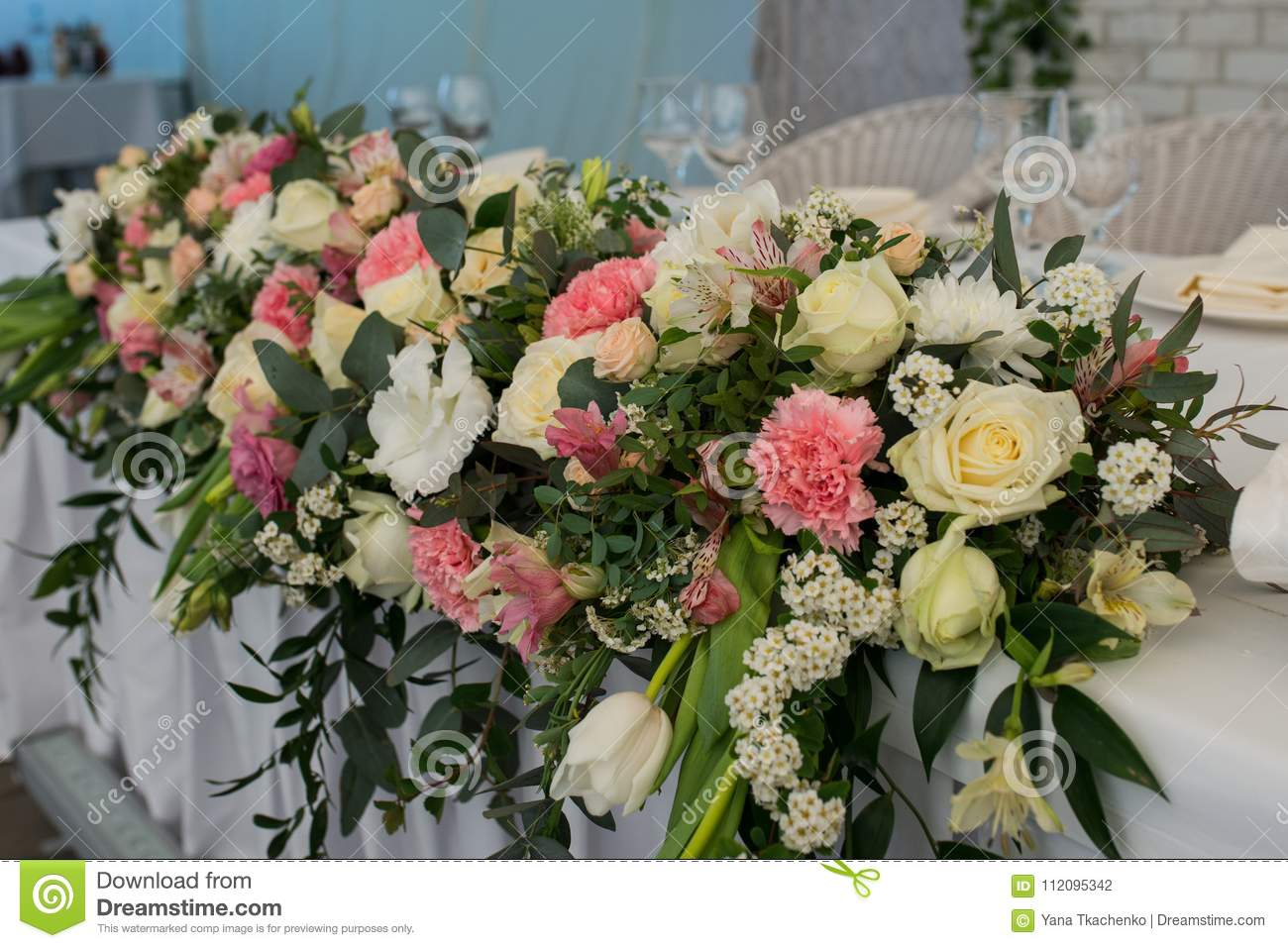 Rustic Flower Arrangement With White And Pink Flowers At A Wedding