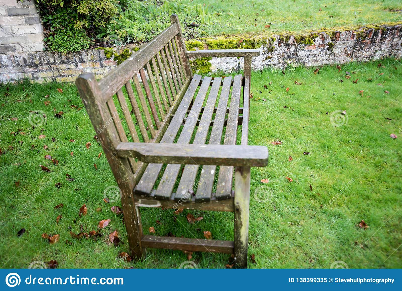 Wondrous Rustic Garden Bench On Bright Green Grass Stock Image Ncnpc Chair Design For Home Ncnpcorg