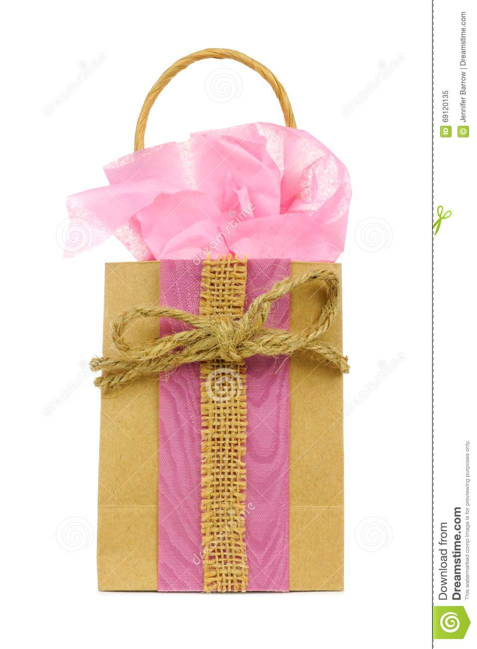 Rustic gift bag with pink tissue wrap and twine bow stock image royalty free stock photo negle Image collections