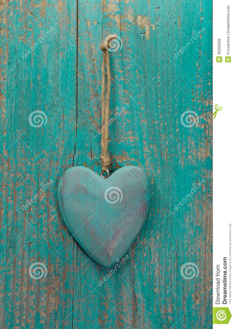 Rustic Heart On Turquoise Wooden Surface For Valentine Birthday