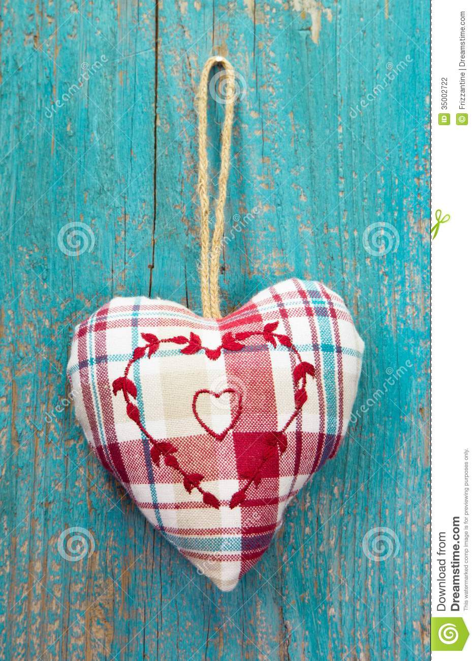 Rustic Heart On Turquoise Wooden Surface For Wedding