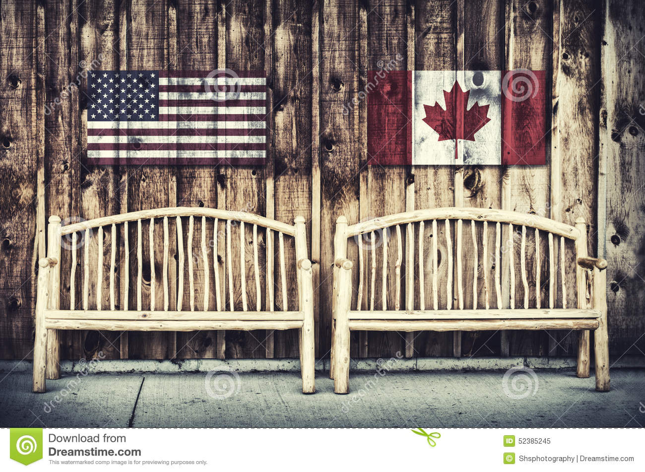 Rustic Log Benches With Usa And Canada Flag Stock Photo