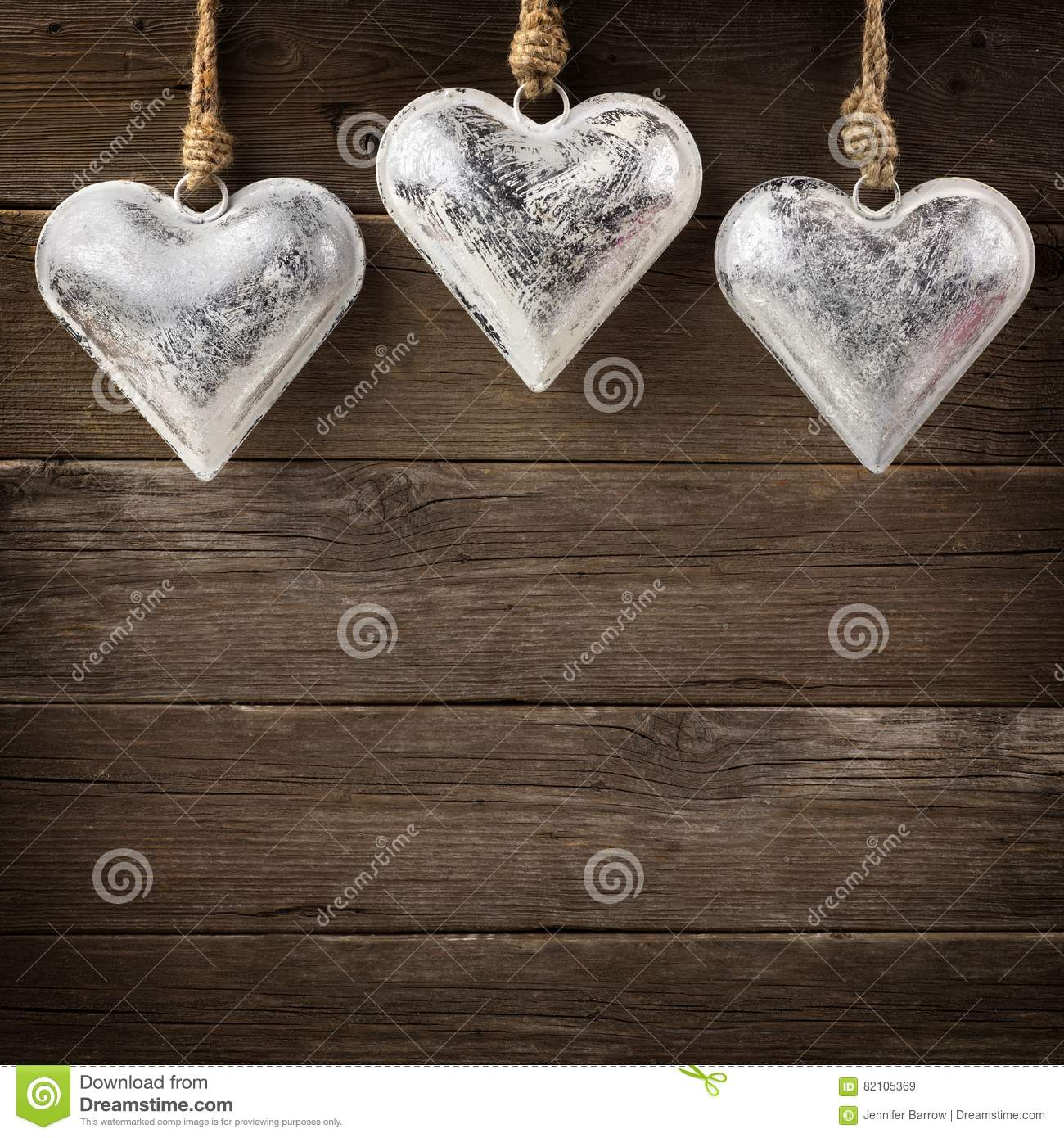 Metal heart ornaments - Against Background Hanging Heart Metal Ornaments