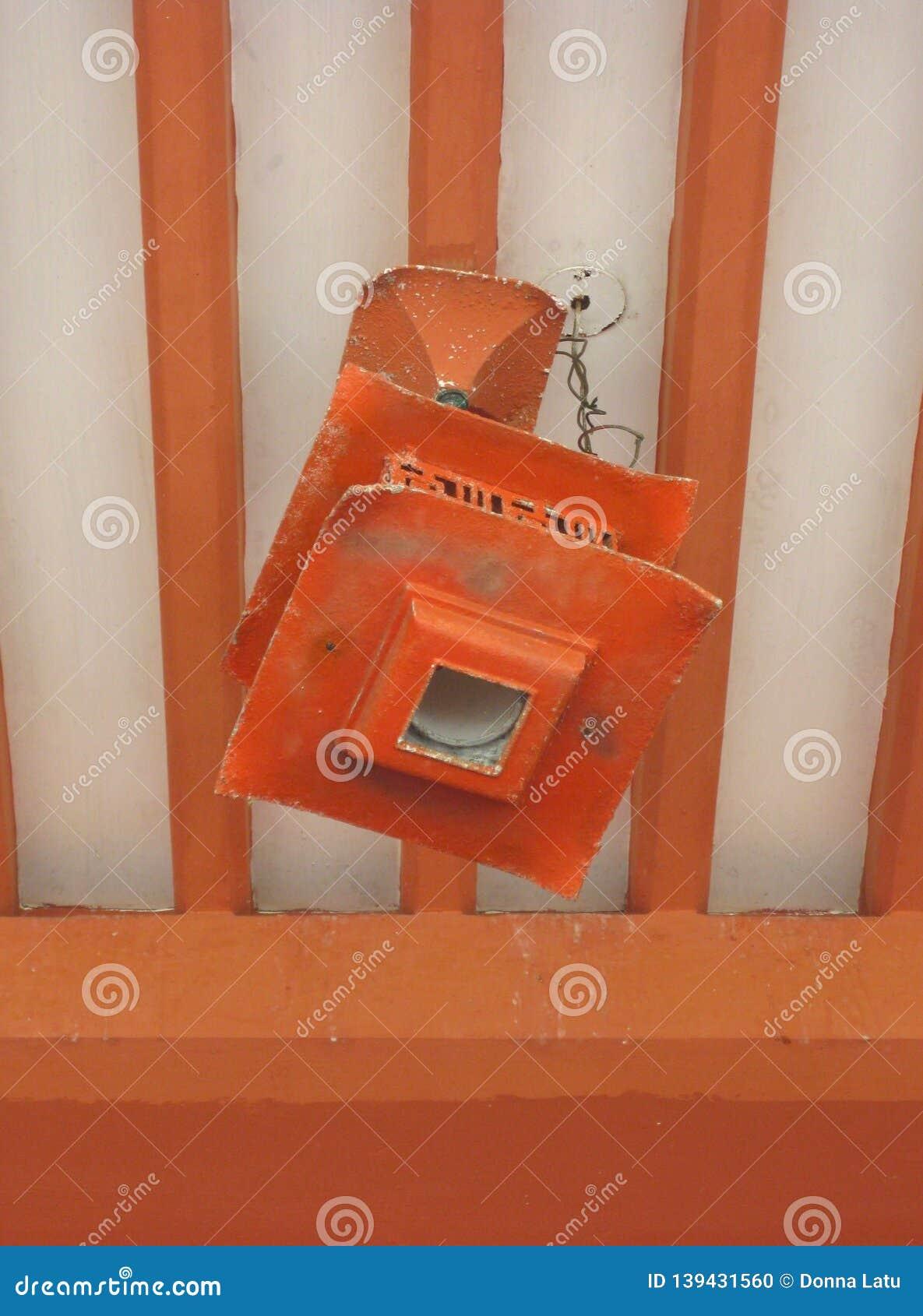 Rustic Japanese lantern hanging from exposed beams