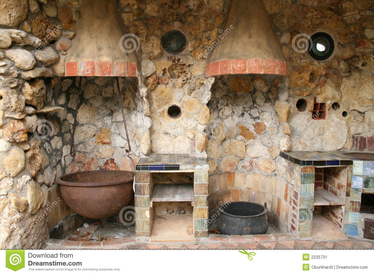 Old pioneer style outdoor kitchen with iron and copper pots and stone ...