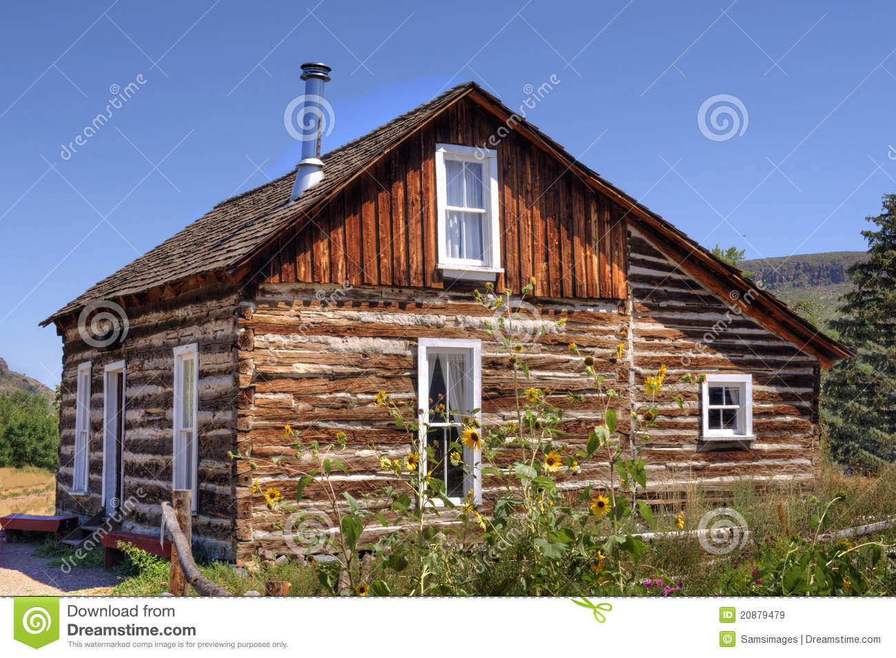 Authentic log cabin circa 1800s in a beautiful summer's day in 2011.