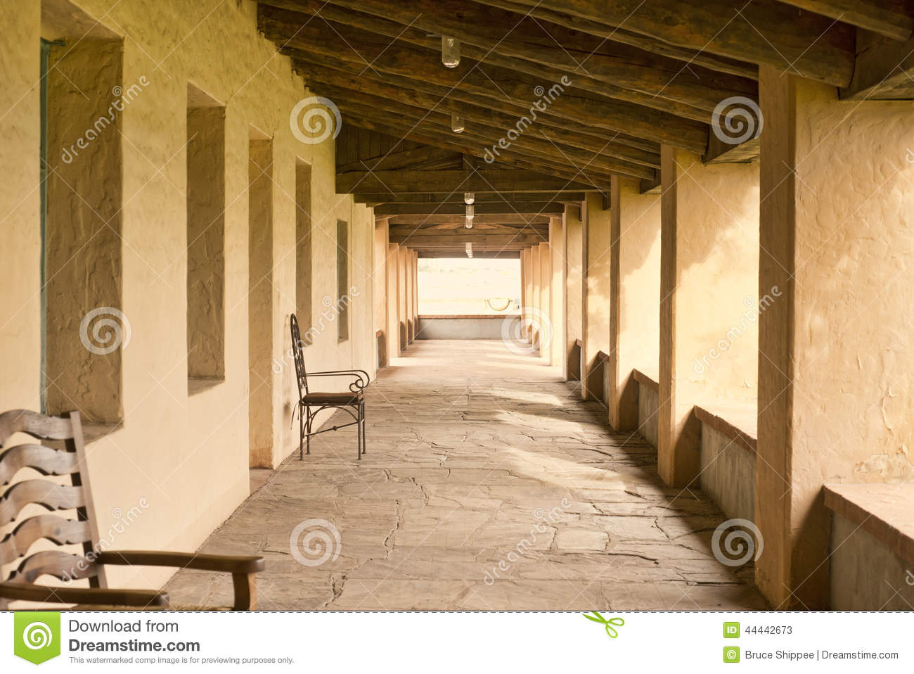 Rustic outdoor covered porch stock image image 44442673 for Rustic porch columns