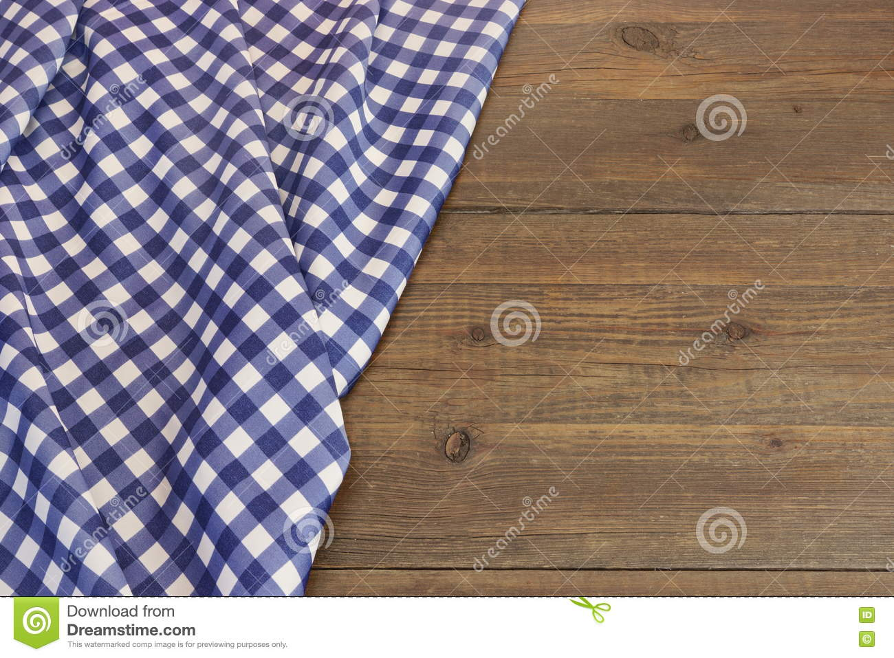 Rustic Picnic Wooden Table With Blue Folded Checkered Tablecloth Royalty  Free Stock Images