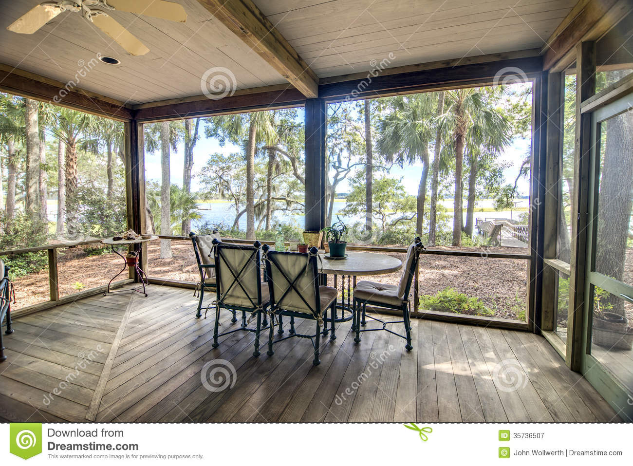 Rustic Porch With Forest And Waterfront View Royalty Free