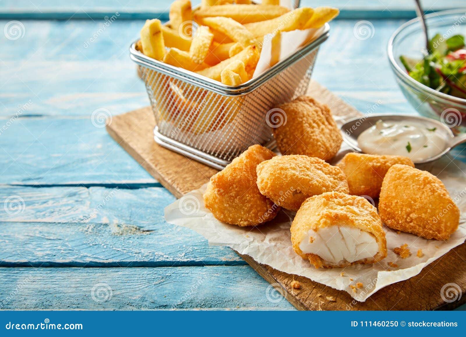 Rustic serving of crumbed fried kibbeling