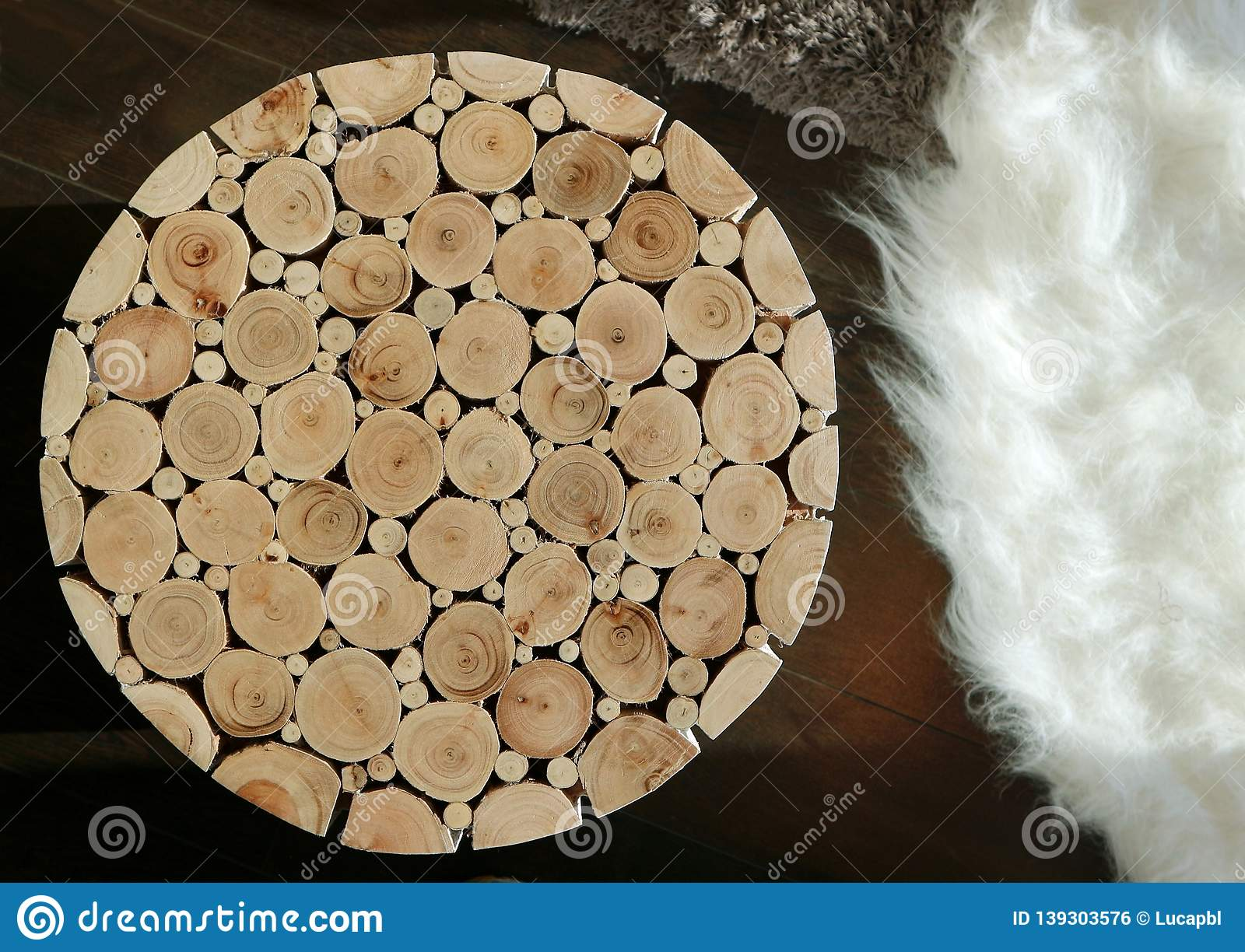 Rustic Small Table Made Of Wooden Circles Of Different Sizes On A