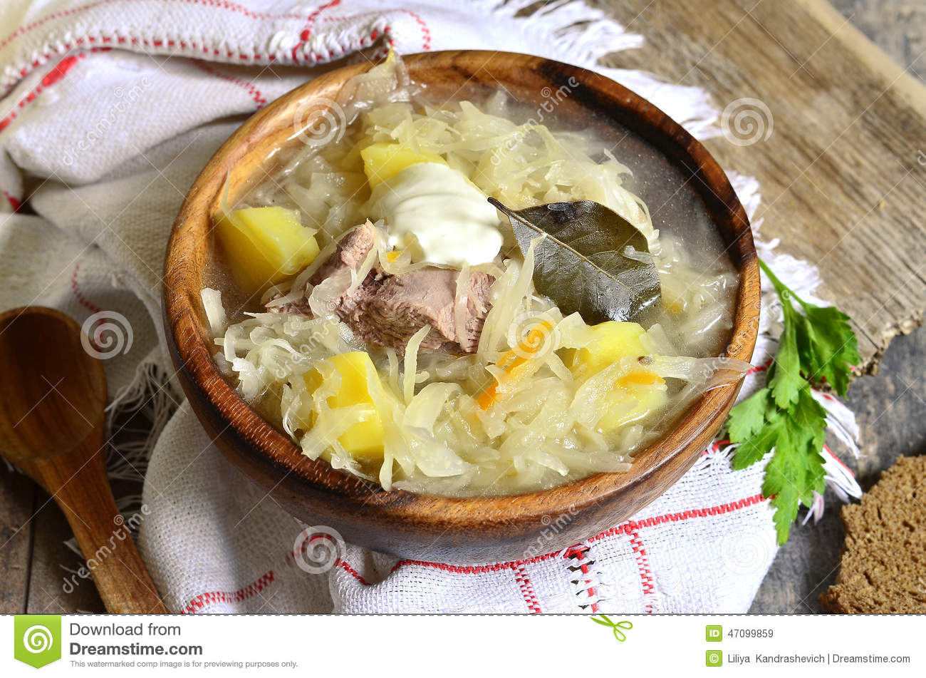 Rustic Sour Cabbage Soup With Goose In A Wooden Bowl. Stock Photo ...