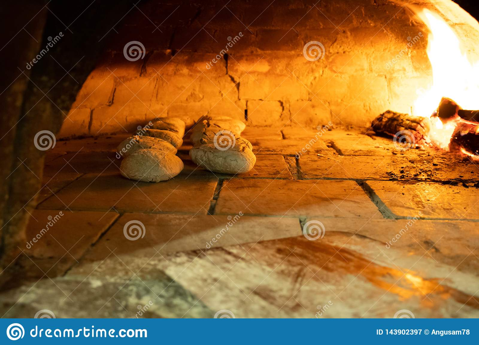 Rustic bread baking in pizza oven
