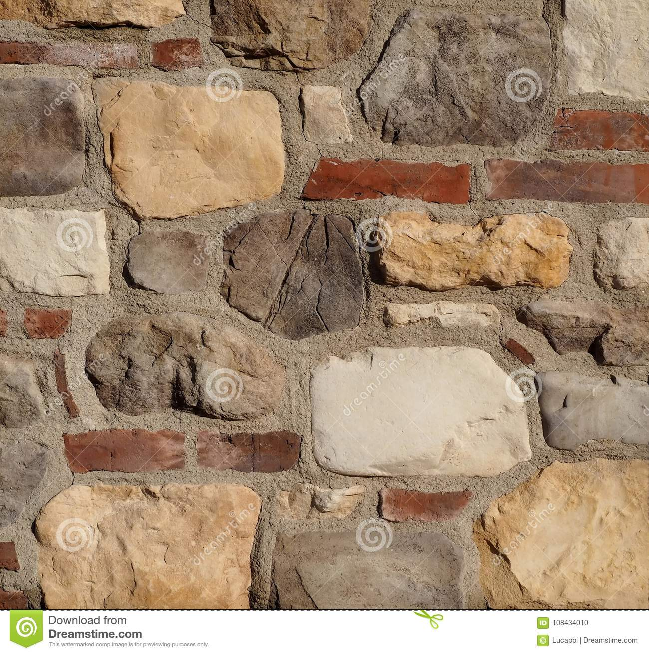 rustic stone wall texture the wall is made of red bricks cement and