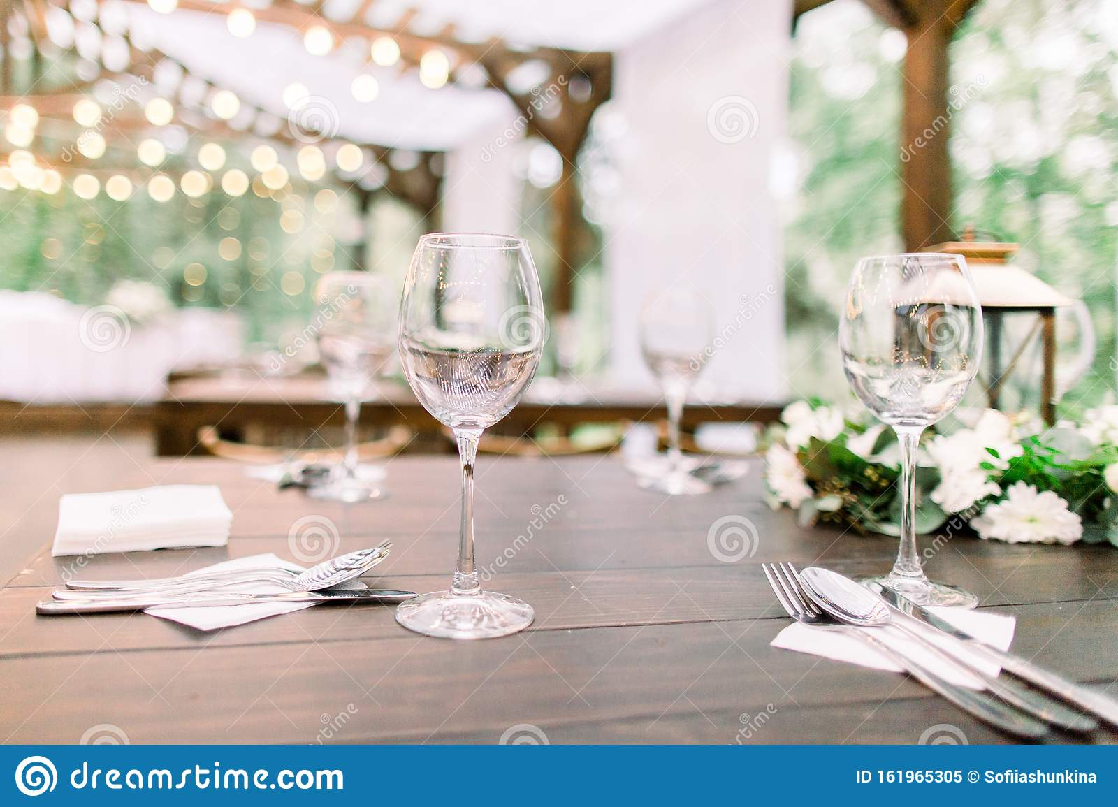 Rustic Table Setting With Floral Decorations Lanterns Wineglasses On The Table Wedding Or Dinner Table In Restaurant Stock Image Image Of Country Bohemia 161965305