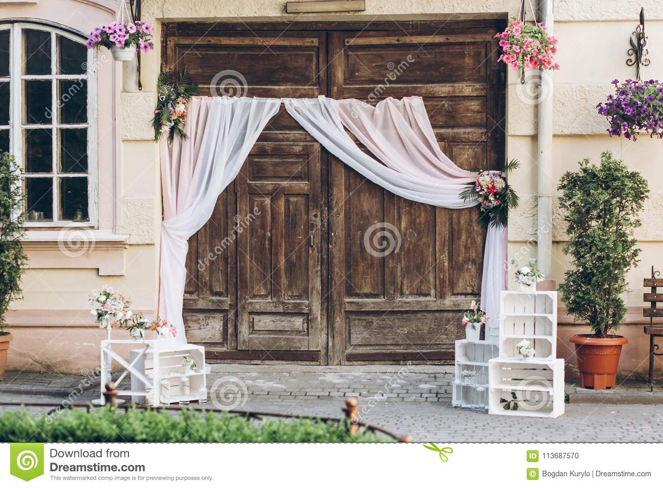 Download Rustic Wedding Photo Zone Wooden Barn Doors With Fabric And Whi Stock