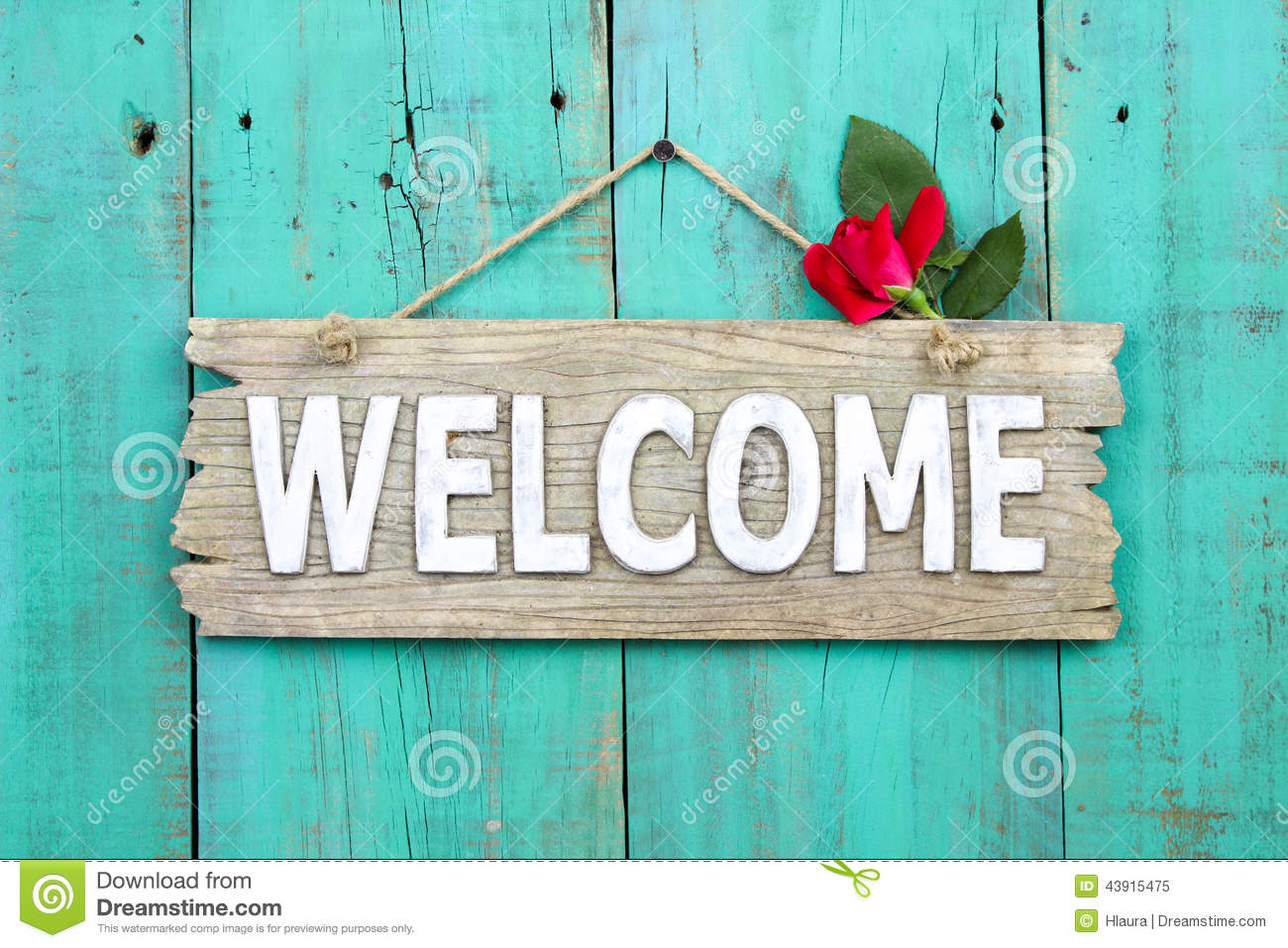 Rustic Welcome Sign With Red Flower Hanging On Distressed