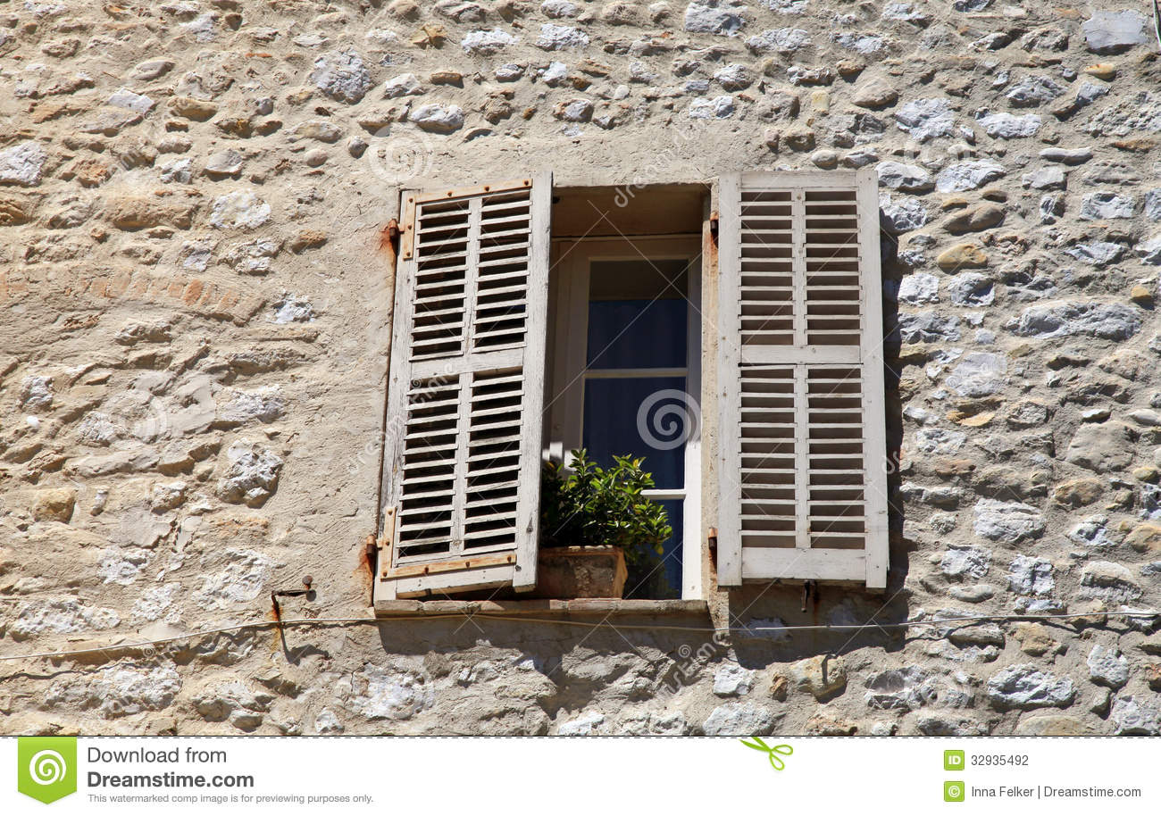 Rustic Window With Old Wood Shutters In Stone Rural House