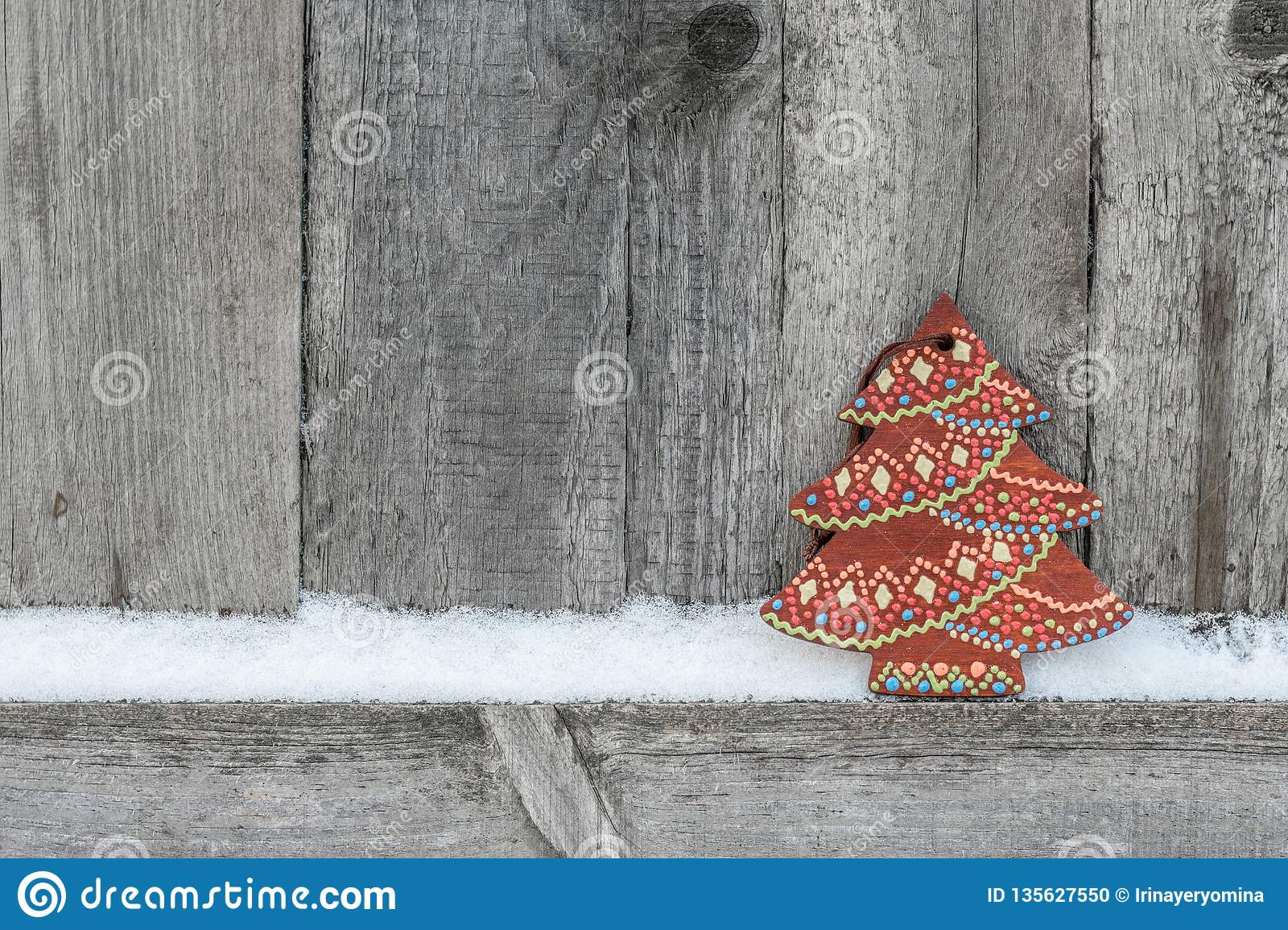Rustic winter background with wooden Christmas tree on wooden texture. Christmas and New Year greeting card background