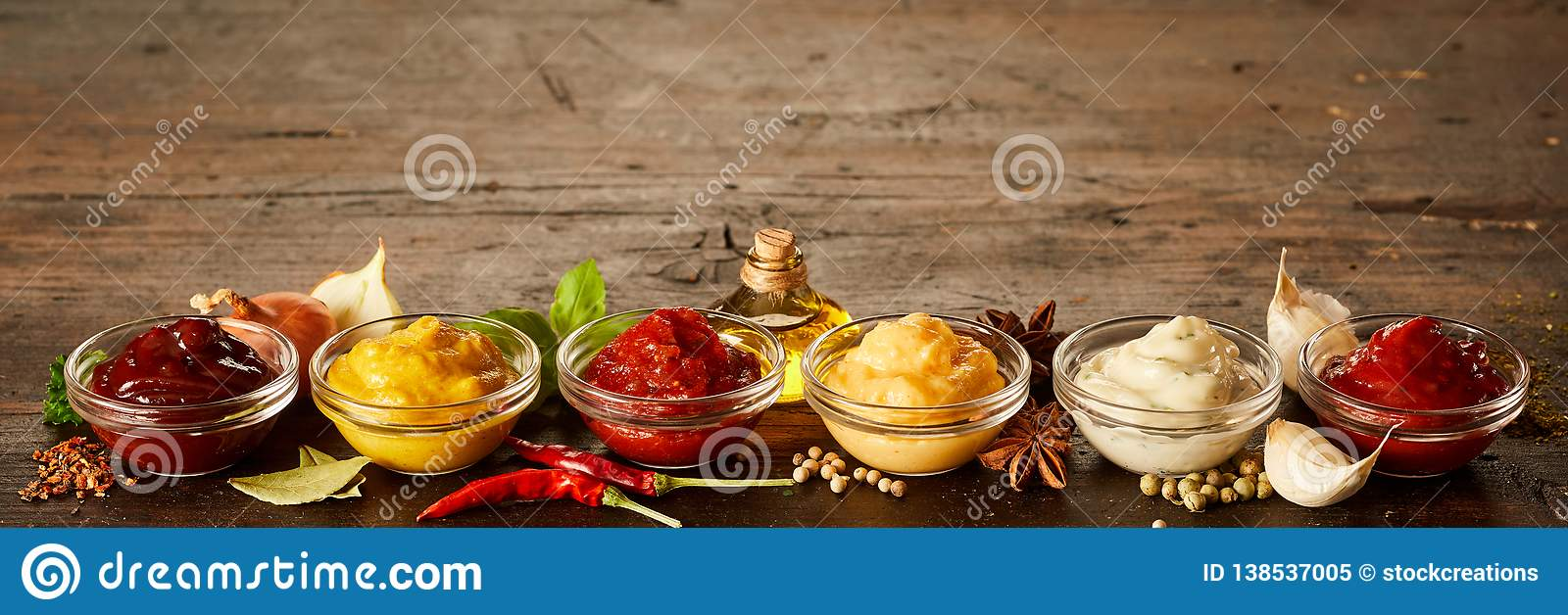 Rustic wood banner with a variety of sauces